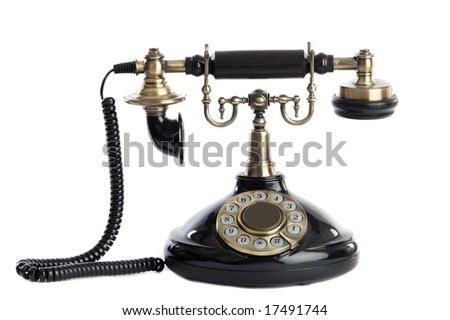 Old vintage black phone a over white background. - stock photo