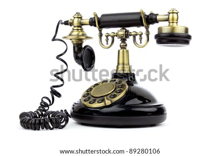 Old vintage black phone over white background - stock photo
