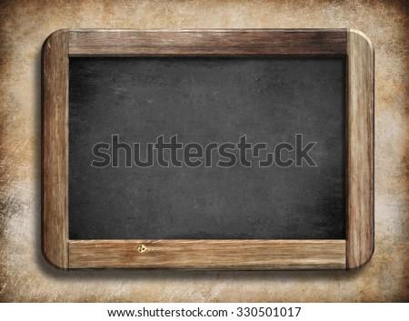 old vintage blackboard with wooden frame on grunge background - stock photo