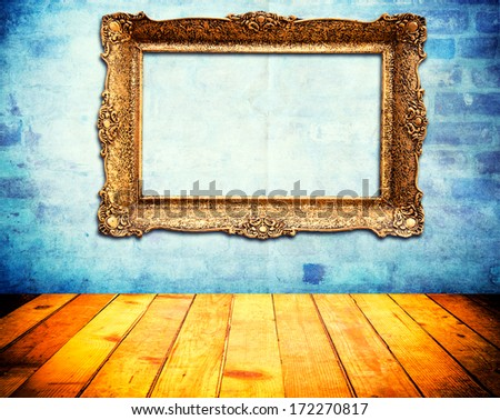 Old vintage blank frame on the abstract wall - stock photo
