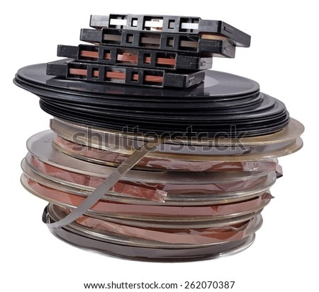 Old vintage bobbins, vinyl records and cassette tapes on a white background  - stock photo