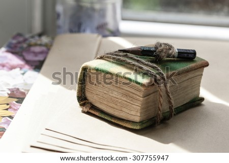 Old vintage book for notes with pencil - stock photo