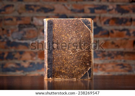 Old vintage book on wooden desk. Retro style filtered photo - stock photo