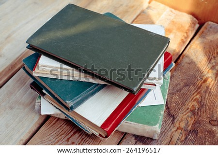 Old vintage books on wooden desk. - stock photo