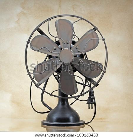 Old vintage brass electric fan - stock photo