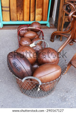 Old vintage brown leather sport balls pile - stock photo