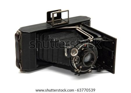 Old vintage camera on white - stock photo