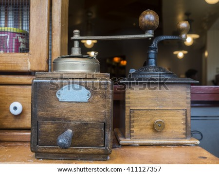 Old vintage coffee blenders on wooden table decoration in shop - stock photo