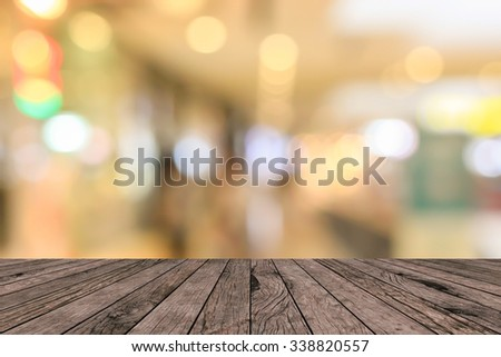 old vintage grungy red brown wood tabletop with blurred warm light colored backgrounds:grunge aged wooden paving with blurry warm cream light bokeh backdrop.put and show your products on this display. - stock photo