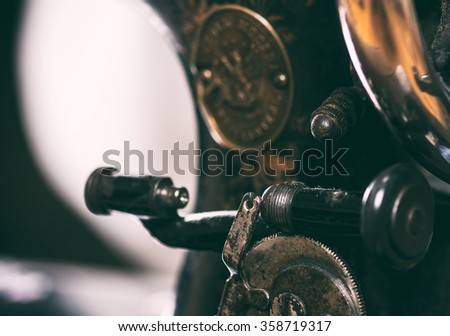 Old vintage hand sewing machine. Selective focus - stock photo