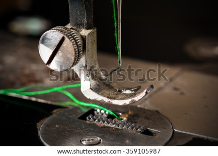 Old vintage hand sewing machine. Sharp needle. Selective focus - stock photo