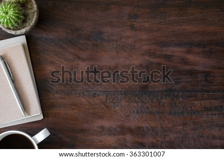 Old vintage office desk table with notebooks, pen and a cup of coffee. Top view with copy space. - stock photo