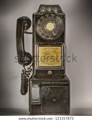 old  vintage pay phone with simple shadows HDR/ Old Pay Phone - stock photo