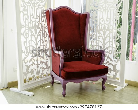 Old vintage red chair - stock photo