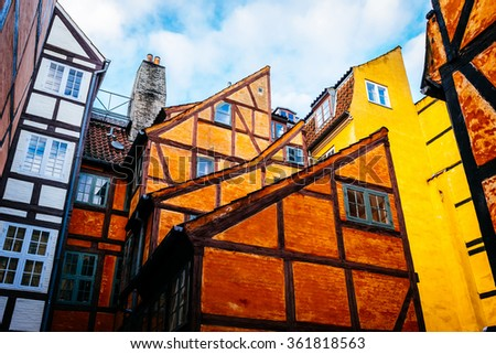 Old vintage retro colorful houses in in old part of town in Copenhagen - stock photo