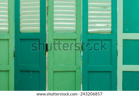 Old vintage shutter wooden door - stock photo