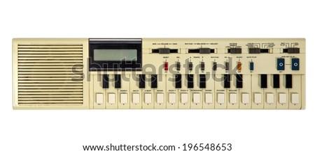 Old vintage synthesizer isolated on white - stock photo