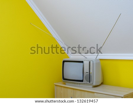 Old, vintage tv set in the corner of the room - stock photo