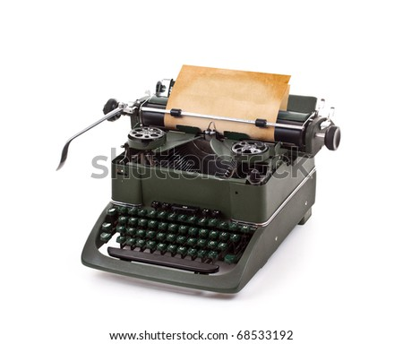 Old vintage typewriter with a blank sheet of paper inserted - stock photo
