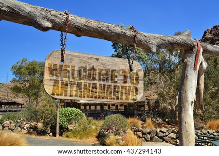 """old vintage wood signboard with text """" welcome to Antananarivo"""" hanging on a branch - stock photo"""