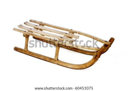 Old vintage wooden sled on white - stock photo