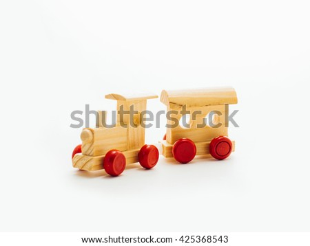 Old vintage wooden toy train on white background. Children toy train made of wood. wooden toy train isolated on white background. Colorful wooden toy train isolated on white background. - stock photo