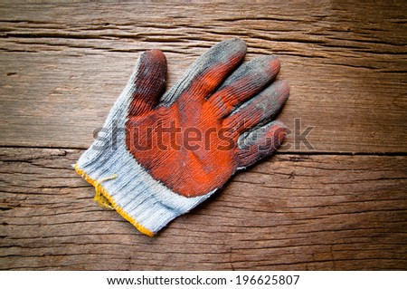 Old Vintage Worn Out Gloves, Gardener, Worker, Carpenter Concept and Idea / On Wood Background, Rustic Style. - stock photo