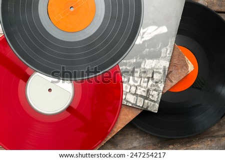 Old vinyl long play records on vintage wooden background. - stock photo