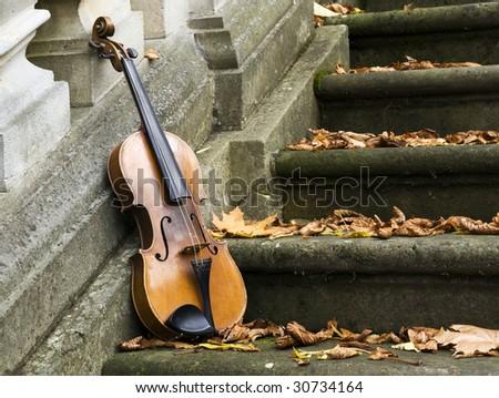 old violin on autumn barok 3 - stock photo