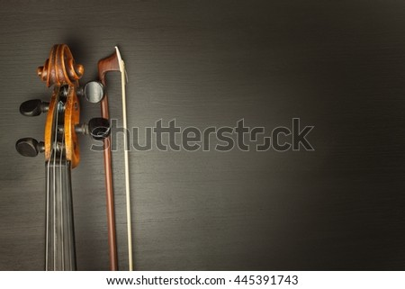 Old violin on dark wooden table. Detail of old violin on a black background. Invitation to the Violin Concerto. - stock photo