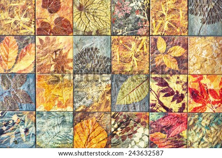 Old wall ceramic tiles patterns handcraft from thailand In the park public. - stock photo