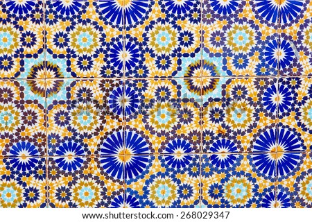 Old wall decorated with beautiful mosaics in Marrakech, Morocco - stock photo
