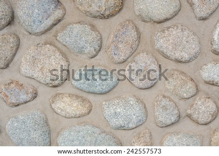 old wall full of oval blocks, architectural background - stock photo