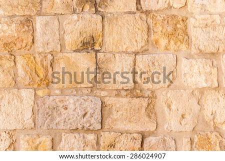 Old wall made of the Jerusalem stone. Israel - stock photo
