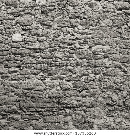 Old wall made of the Jerusalem stone. Wall constructed of stone bricks. - stock photo