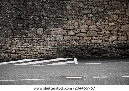 old wall, modern street. - stock photo