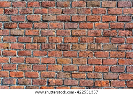 old wall of red and orange bricks for texture, or background - stock photo
