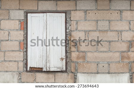 Old  wall with a window - stock photo
