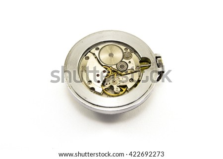 Old watch mechanism on white background - stock photo