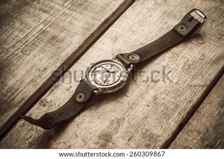 Old  watches on a wooden window sill - stock photo