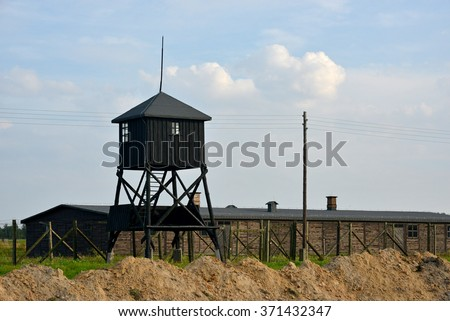 Old watchtower, barracks and  wire entanglement - Majdanek ( KL Lublin) concentration camp. - stock photo