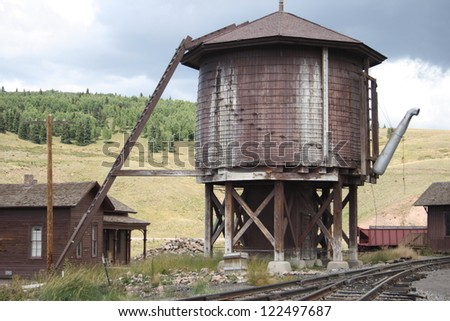 Old water tower for steam locomotives on the Cumbres-Toltec Narrow Gauge Railway line in northern New Mexico/southern Colorado. - stock photo