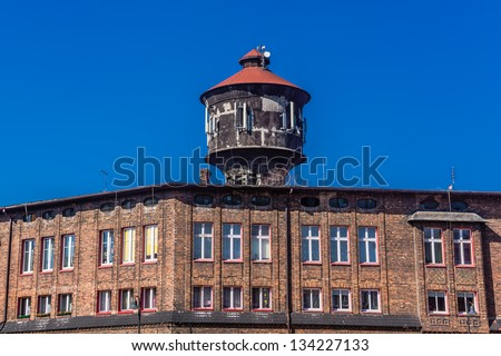 Old water tower in Nikiszowiec, district of Katowice, Silesia region Poland. The place is unique historic coal miners' settlement, built between 1908 - 1918. - stock photo