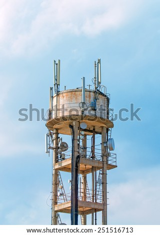 Old water tower with cellular communications. - stock photo
