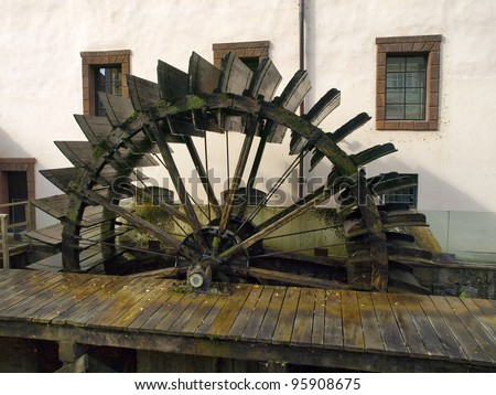 old watermill with waterwheel worked as hdr - stock photo