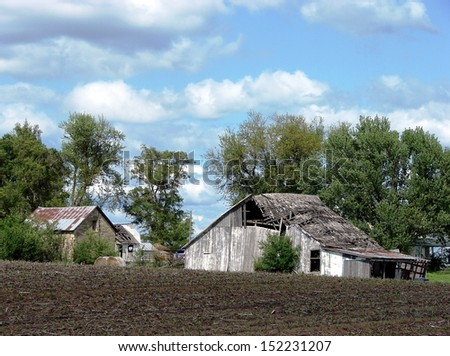 old weathered abandoned building farmyard - stock photo