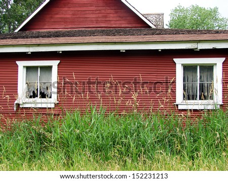 old weathered abandoned building red barn - stock photo