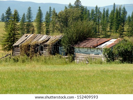 old weathered abandoned buildings granary shed - stock photo