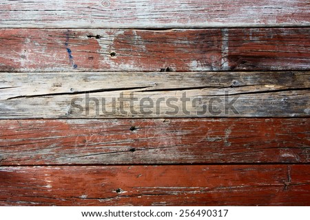 Old weathered barn wood texture with knots and nail holes. - stock photo