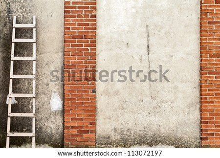 old, weathered brick wall background, ladder on the left side - stock photo